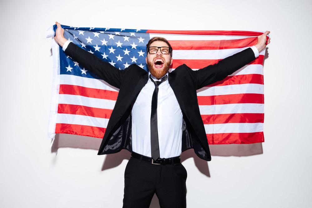 Бизнесмен с американским флагом